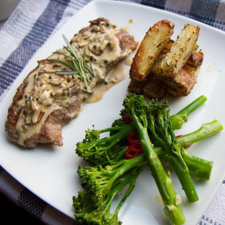 Steak with a Peppercorn, Mushroom, and Brandy Sauce