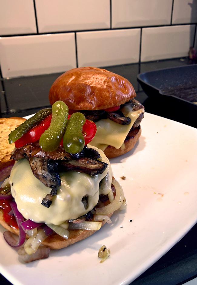Homemade burger with Brioche bun, minced beef, Portobello mushrooms, onions, Fol Epi cheese and cornichons